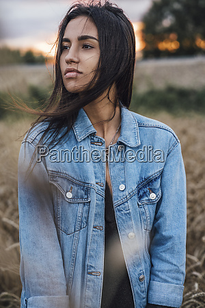 portrait of young woman wearing denim