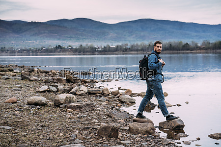 russia amur oblast man with backpack