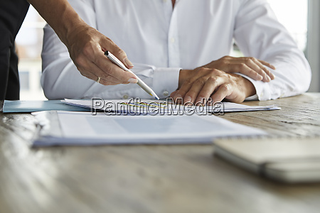 businessman and woman discussing project