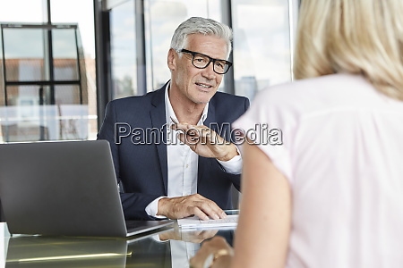 businessman snd woman sitting in office