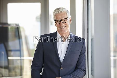 portrait of a successful businessman standing