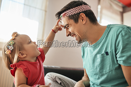 father and little girl having fun