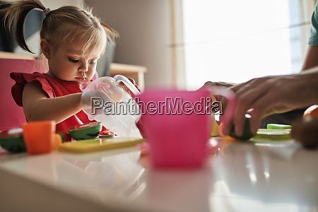 little girl playing together with her