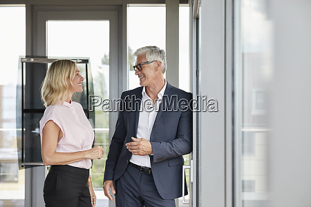 businessman and woman standing in office