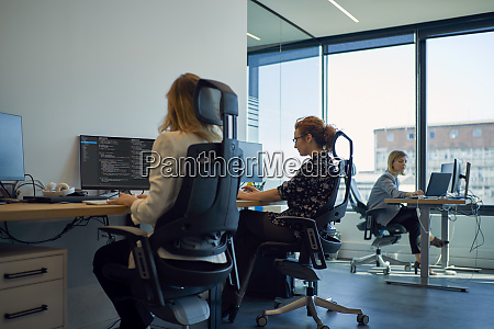businesswomen using computers in office