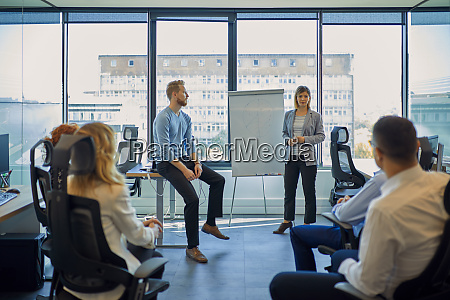 businesswoman leading a presentation at flip