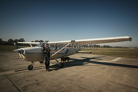 male pilot standing at small propellor