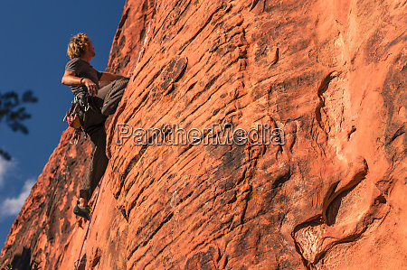 view from below of adventurous man