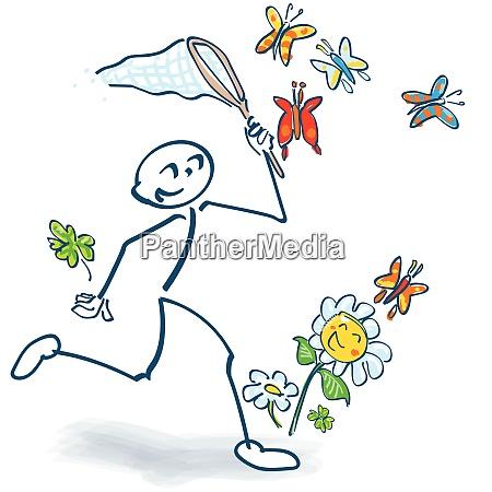 stick figure captures butterflies and flowers