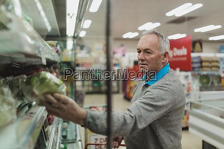 senior man in the supermarket