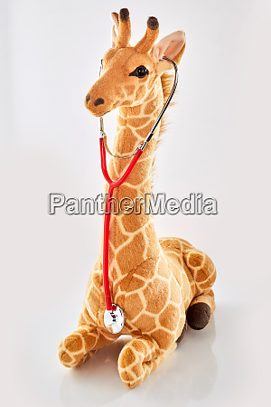 giraffe stuffed toy listening to a