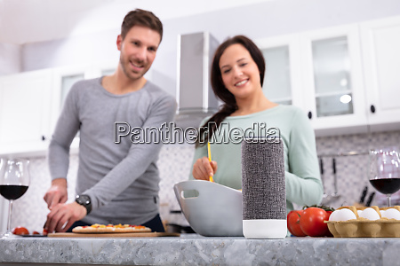 portrait of young couple preparing food