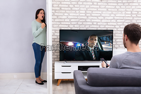 angry woman with neighbor man watching