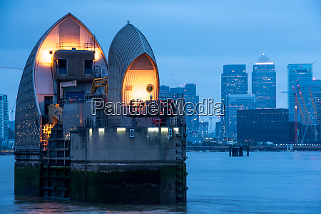 thames barrier and canary wharf at