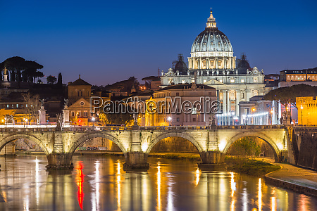 illuminated st peters basilica and the