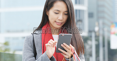 young woman using mobile phone and