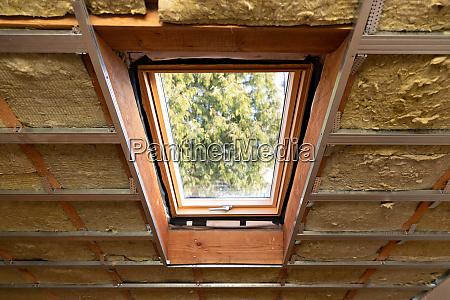 metal frames on attic skylight window