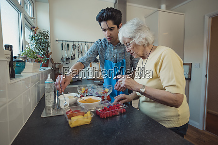 making fruit compote with grandmother