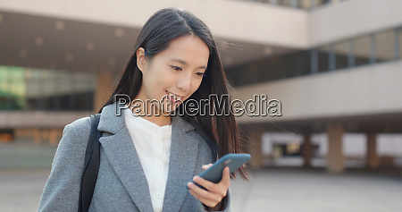 young business woman use of mobile