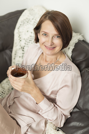 portrait of mature woman smiling while