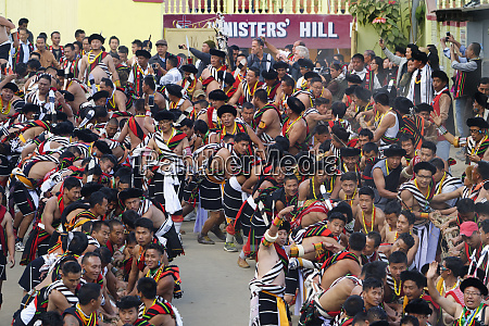 naga tribesmen participating at the stone
