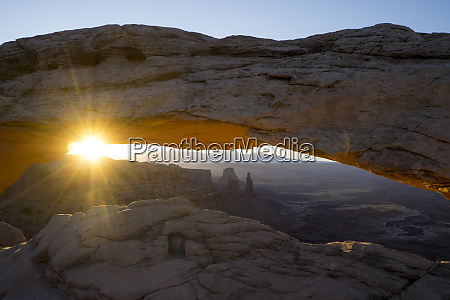 delicate arch with rising sun arches