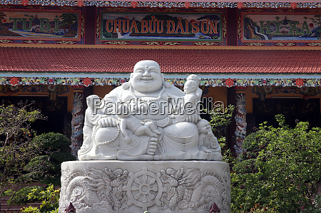 statue of the smiling buddha the