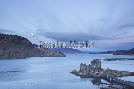 moon setting at eilean donan castle