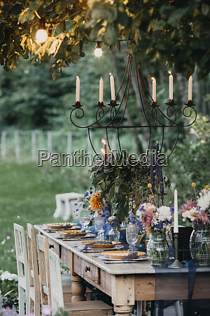 festive laid table with candles under