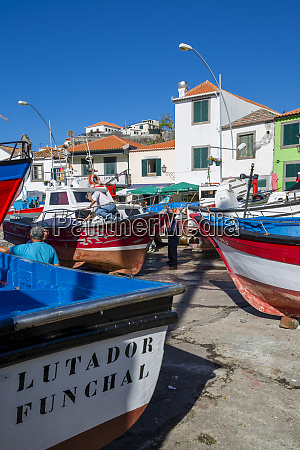 colourful fishing boats in harbour in