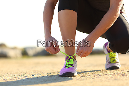 runner tying shoe laces outdoors