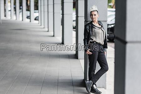 portrait of punk woman leaning against