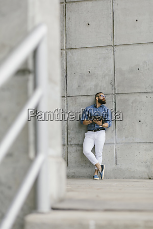 bearded hipster businessman with digital tablet