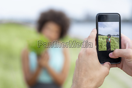 cell phone picture of woman holding