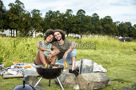 happy couple having a barbecue in