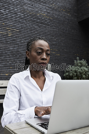portrait of businesswoman sitting on