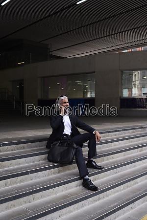 stylish senior businessman on the phone