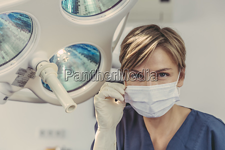 dental surgeon wearing surgical mask portrait