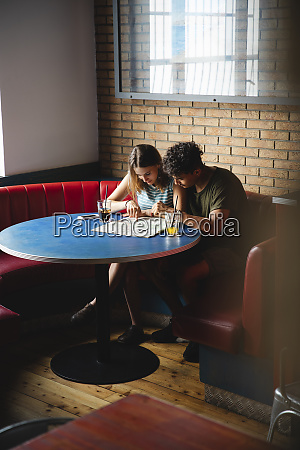 young couple sitting at table in