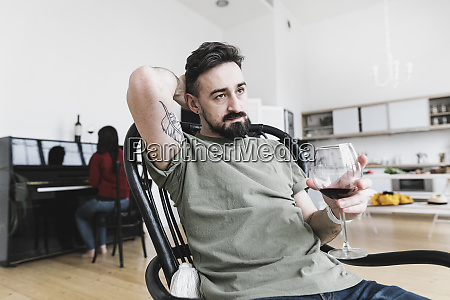 couple at home man drinking wine