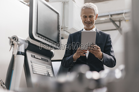manager using digital tablet in high