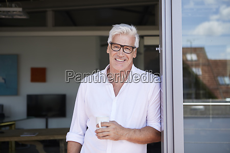portrait of smiling mature man holding
