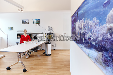 young woman sitting at desk in