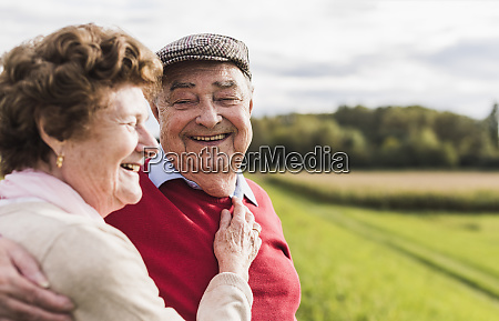 happy senior couple embracing in rural