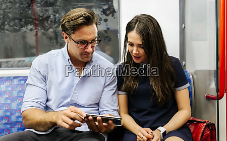 uk london couple sharing cell phone