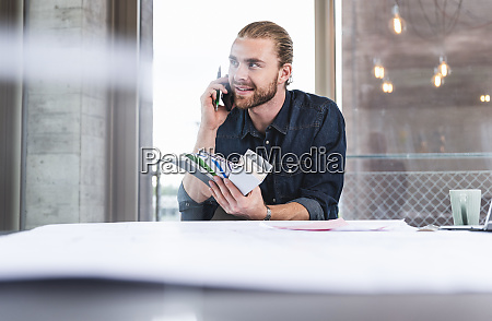 young man on cell phone holding