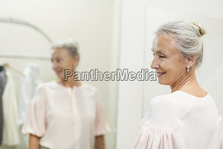smiling senior woman in a boutique