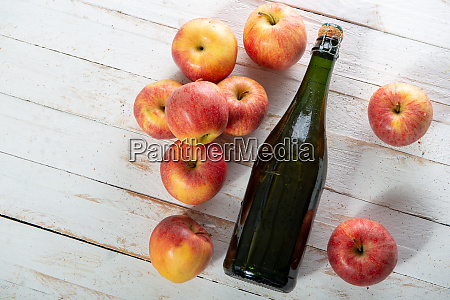 organic apples with a bottle of