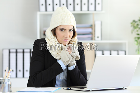 angry businesswoman having cold at office