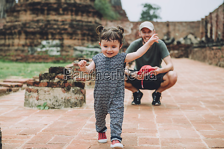 thailand ayutthaya father observing his baby
